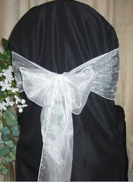 black chair cover with white organza sash